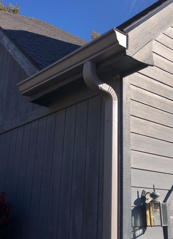 Bulldog Gutter Guard, Downspouts & Gutters put up in Lawrence, KS - After Photo