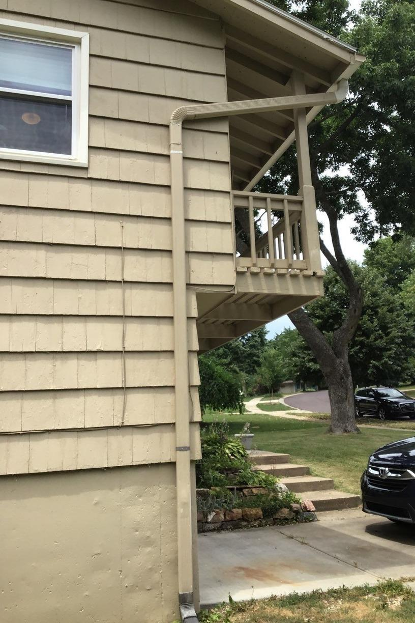 Gutters, Elbows and Downspouts Installed on Home in Overland Park, KS - Before Photo