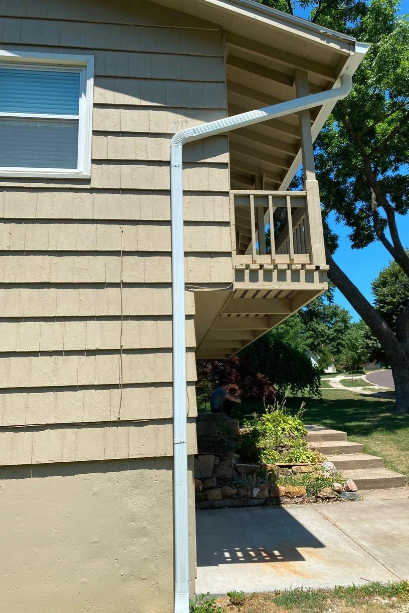 Gutters, Elbows and Downspouts Installed on Home in Overland Park, KS - After Photo
