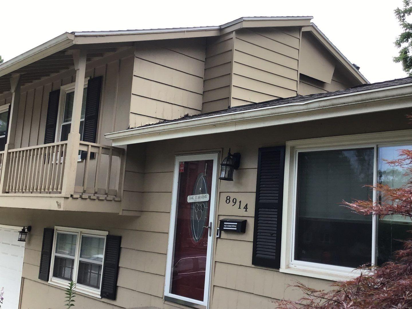 5 inch Gutters and Downspouts Installed on Home in Overland Park, KS - Before Photo