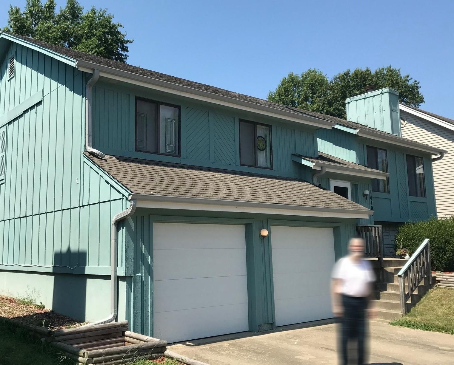 Siding Repair and Exterior Painting for a Home in Grandview, MO - Before Photo