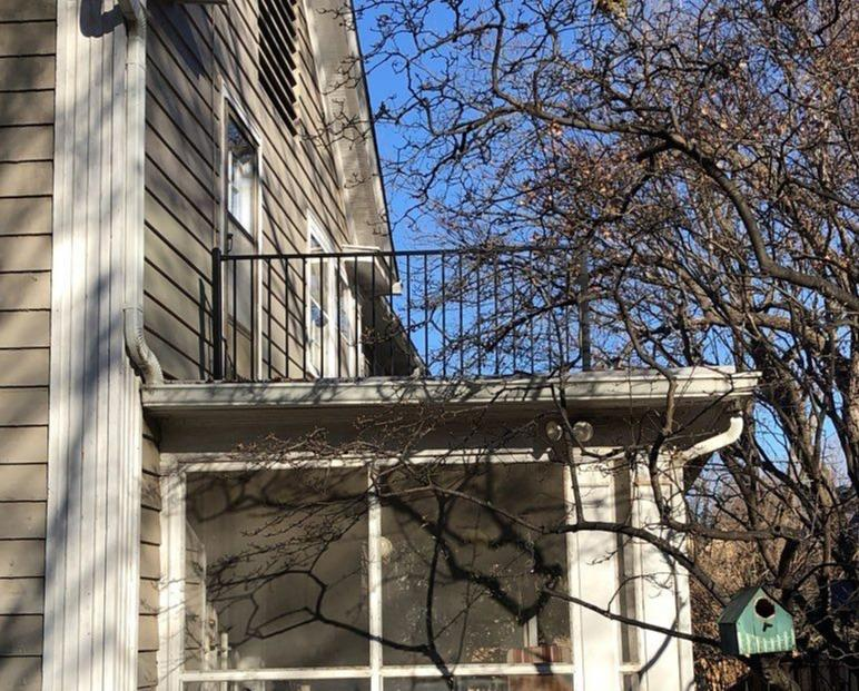 Railings and Flat Roof Put Up Above Screen Porch in Kansas City, MO - After Photo