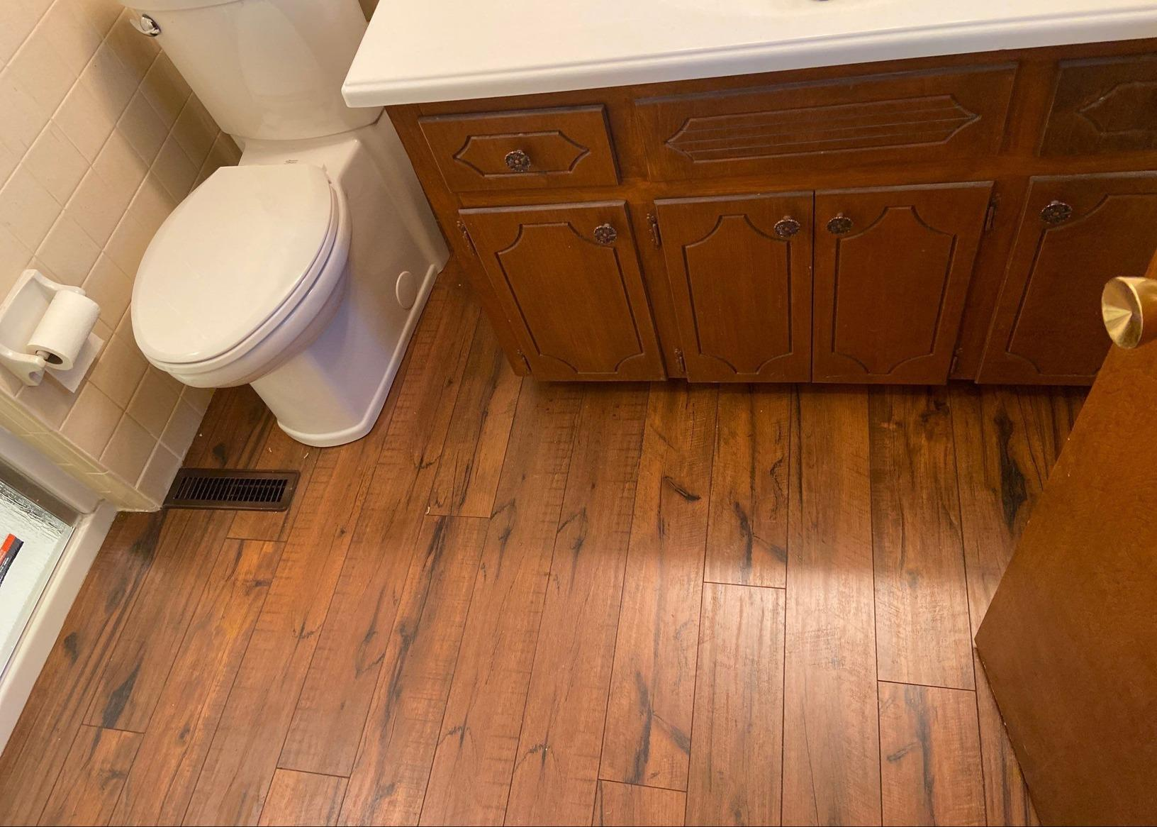 Gladstone, MO Upstairs Bathroom with New Laminate Flooring - After Photo