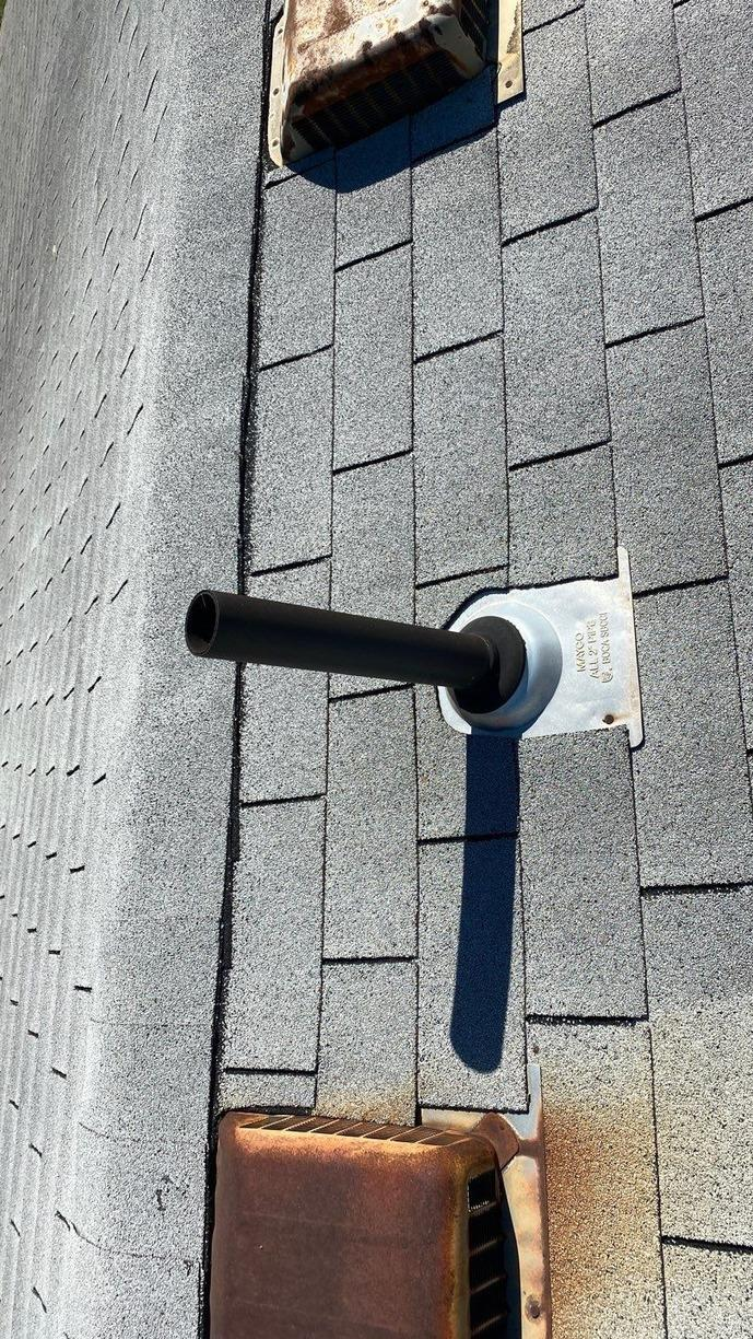 Ventilation Box Vents and New Shingles Installed on Roof of a Home in Raytown, MO - Before Photo