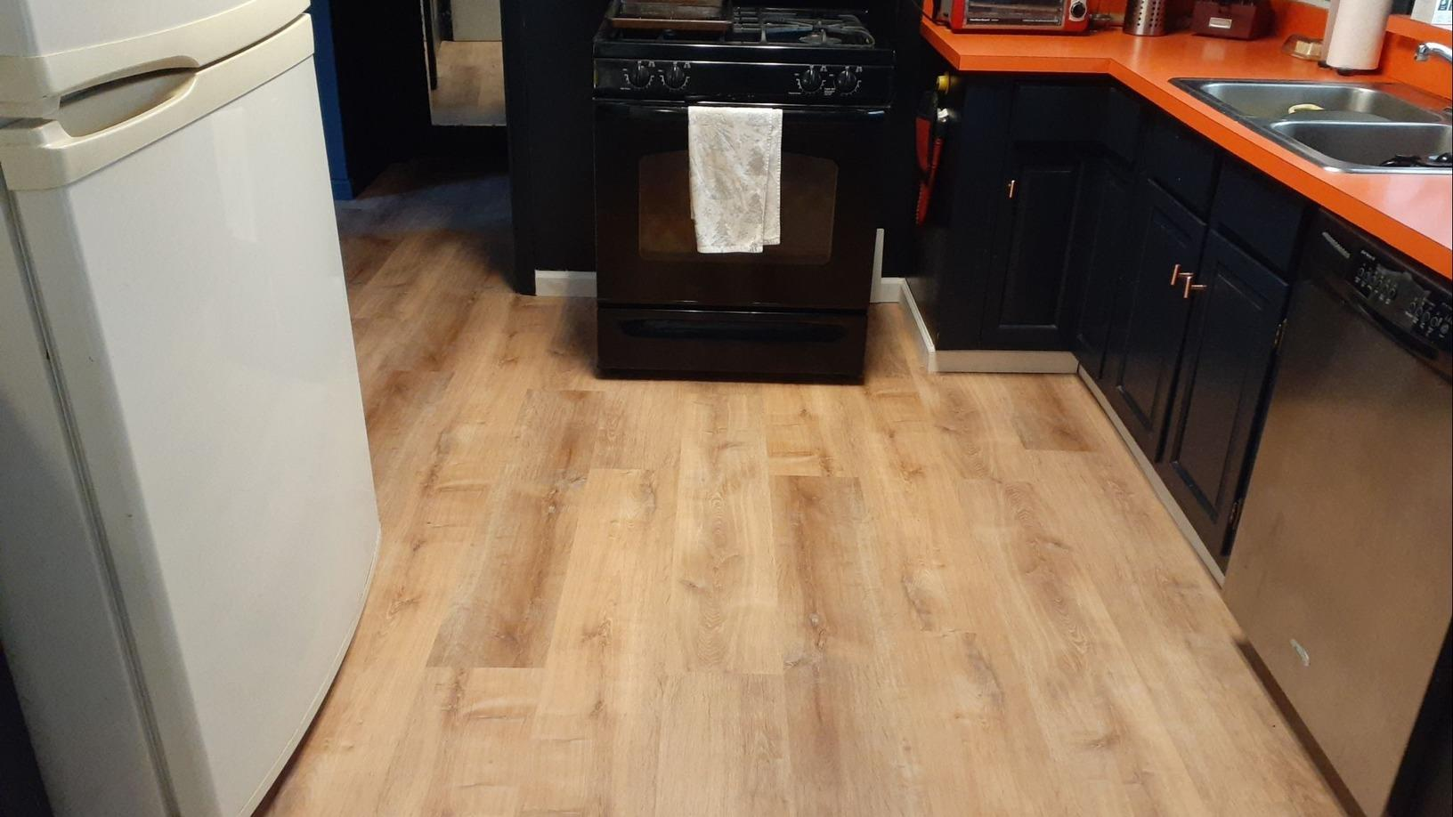 Flooring Installed in the Kitchen, Living Room and Bar in Raytown, MO - After Photo