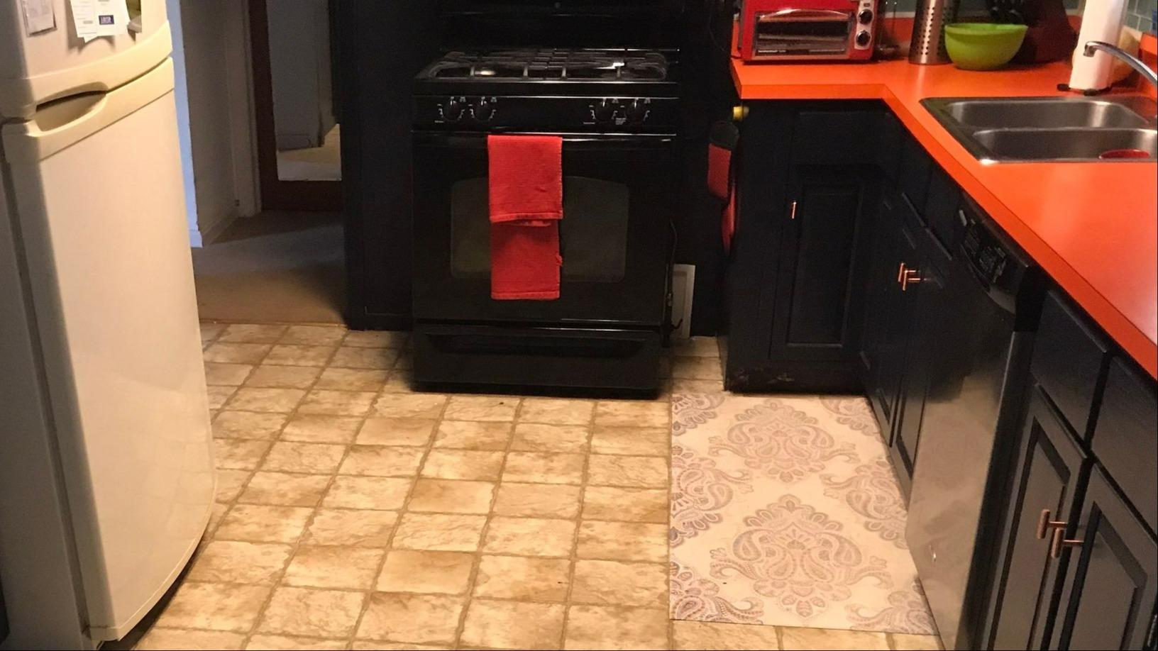 Flooring Installed in the Kitchen, Living Room and Bar in Raytown, MO - Before Photo