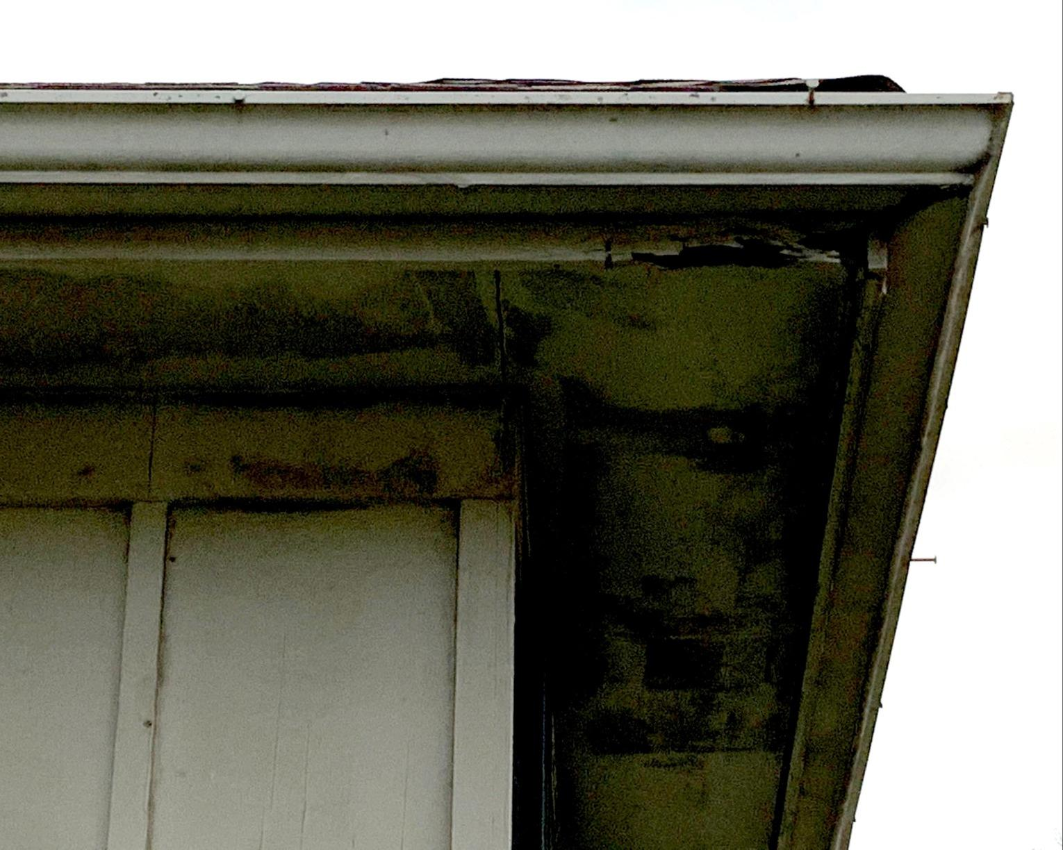 Gutters and New Fascia/Soffit and Siding Repair on a Home in Kansas City, MO - Before Photo