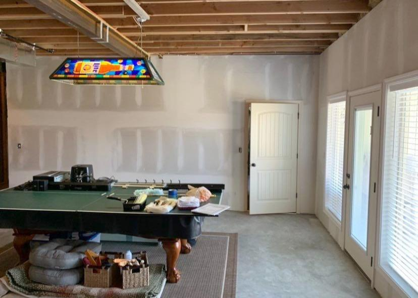 Basement in Riverside, MO with Installation of Drywall and Window and Door Casings - After Photo