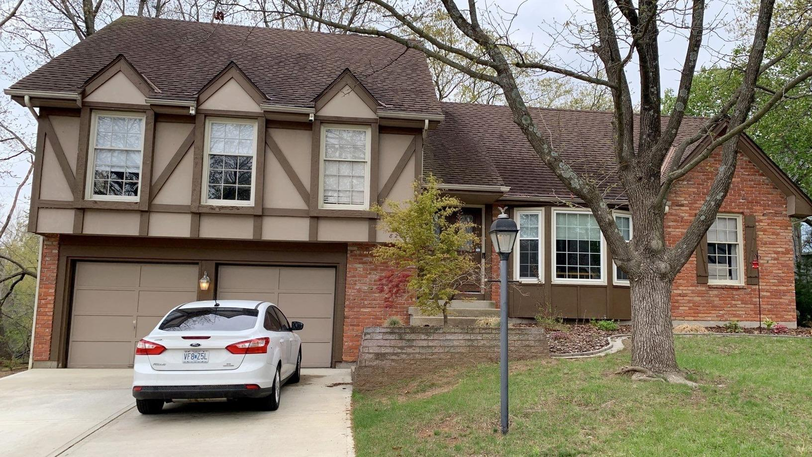 Gutters, Trim and New Paint on a Home in Kansas City, MO - Before Photo