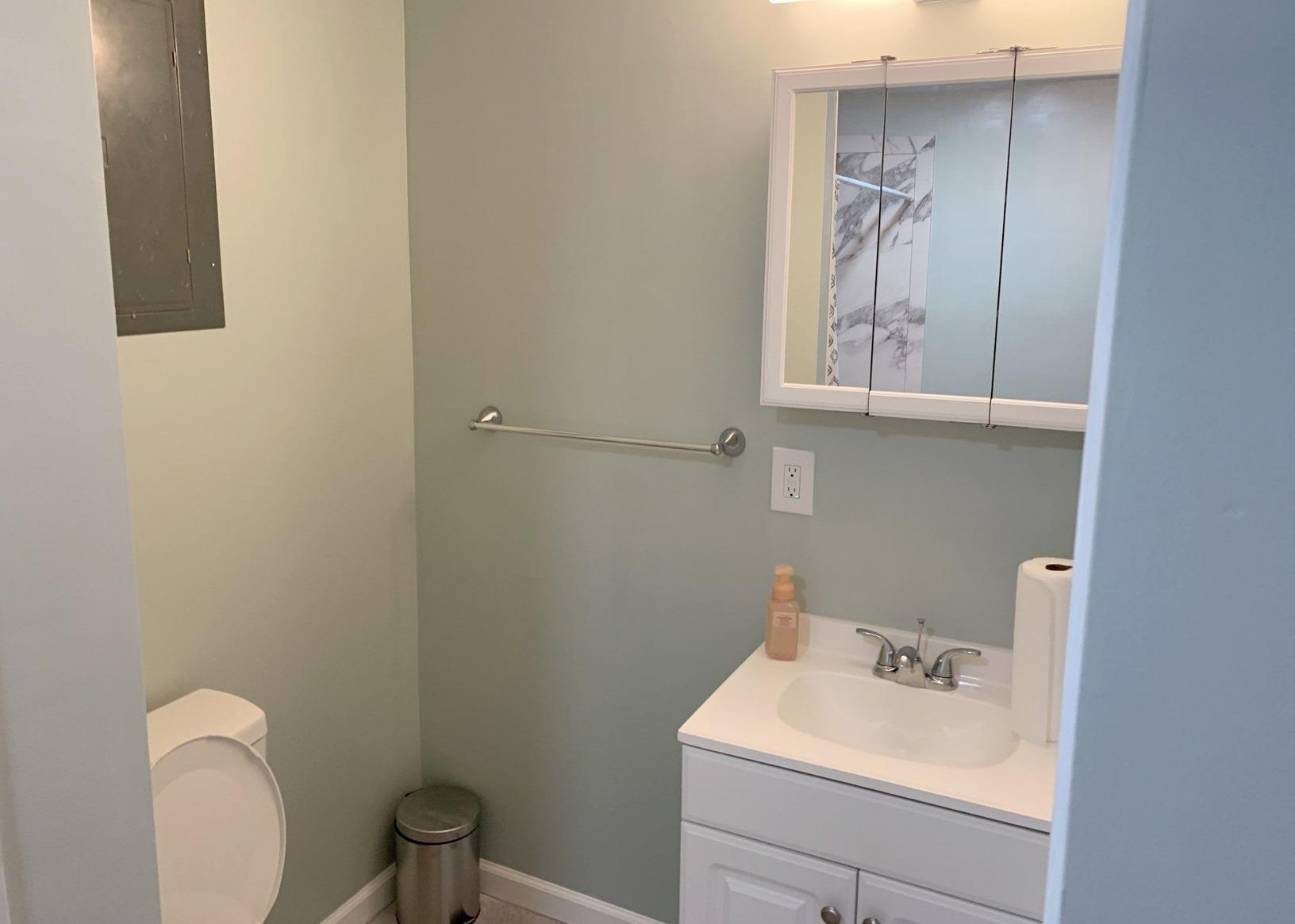 Bathroom Vanity, Mirror and Toilet Installed in a Basement in Grandview, MO - After Photo
