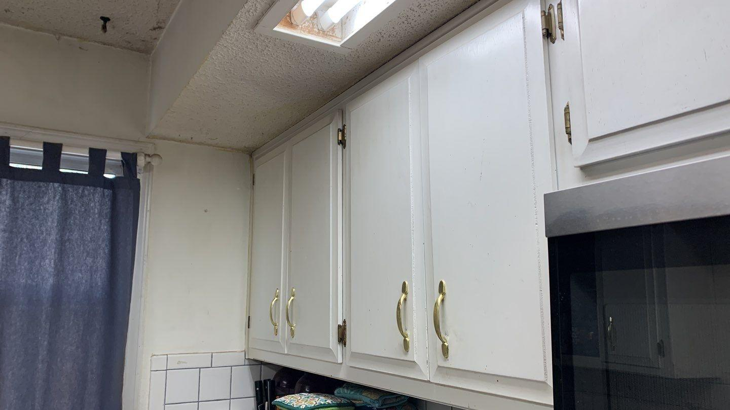 Cabinets with Full Extension Drawer Glides & Hidden Hinges in Kansas City, MO Kitchen - Before Photo