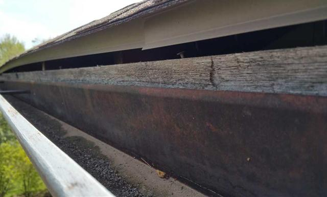 Gutter and Soffit Replacement in Stilwell, KS - Before Photo