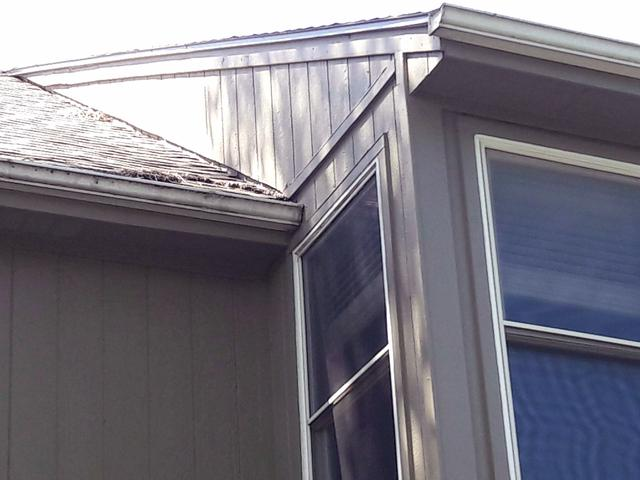 Olathe, KS Home. New Gutter and Downspouts - Before Photo