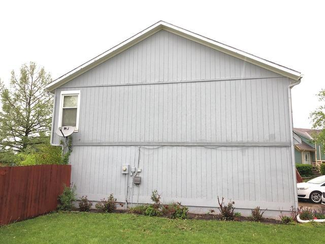 LP Grooved Siding Replaced at Gardner, KS Home - Before Photo