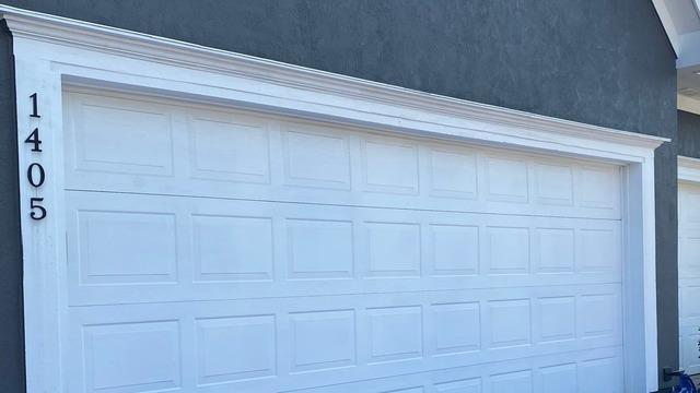 Garage Door Area that Had Wood Rot Replaced and Painted in Kansas City, MO