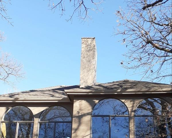 Stucco Siding Repair on Chimney in Shawnee, KS - After Photo