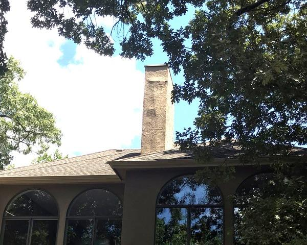 Stucco Siding Repair on Chimney in Shawnee, KS - Before Photo