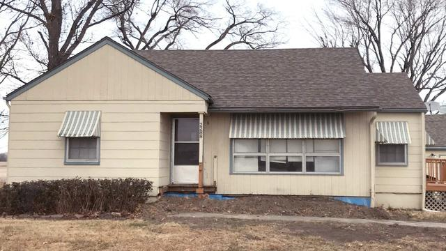 Almond Colored Downspouts with Blue Gutters Installed in Eudora, KS