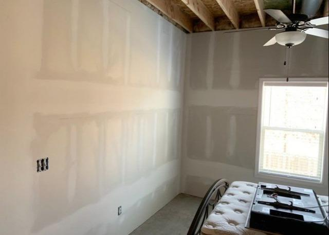 Basement Bedroom with Drywall and Window Casing Installed in Riverside, MO