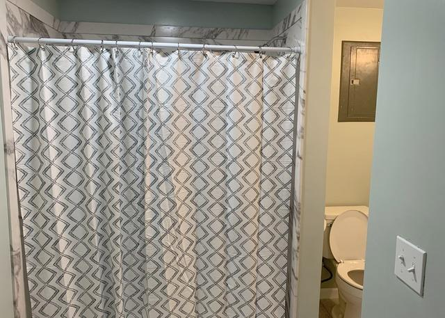 Utility area Converted to a Bathroom at a Home in Grandview, MO