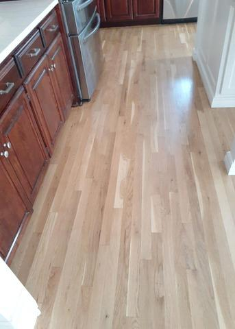 Refinished Flooring in the Kitchen at a Home in Leawood, KS