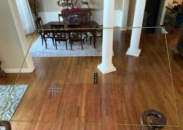Dining Room with Refinished Flooring at a Home in Leawood, KS