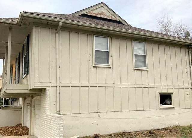 Removal of Old Gutters and Rotted Siding in Kansas City, MO - Before Photo
