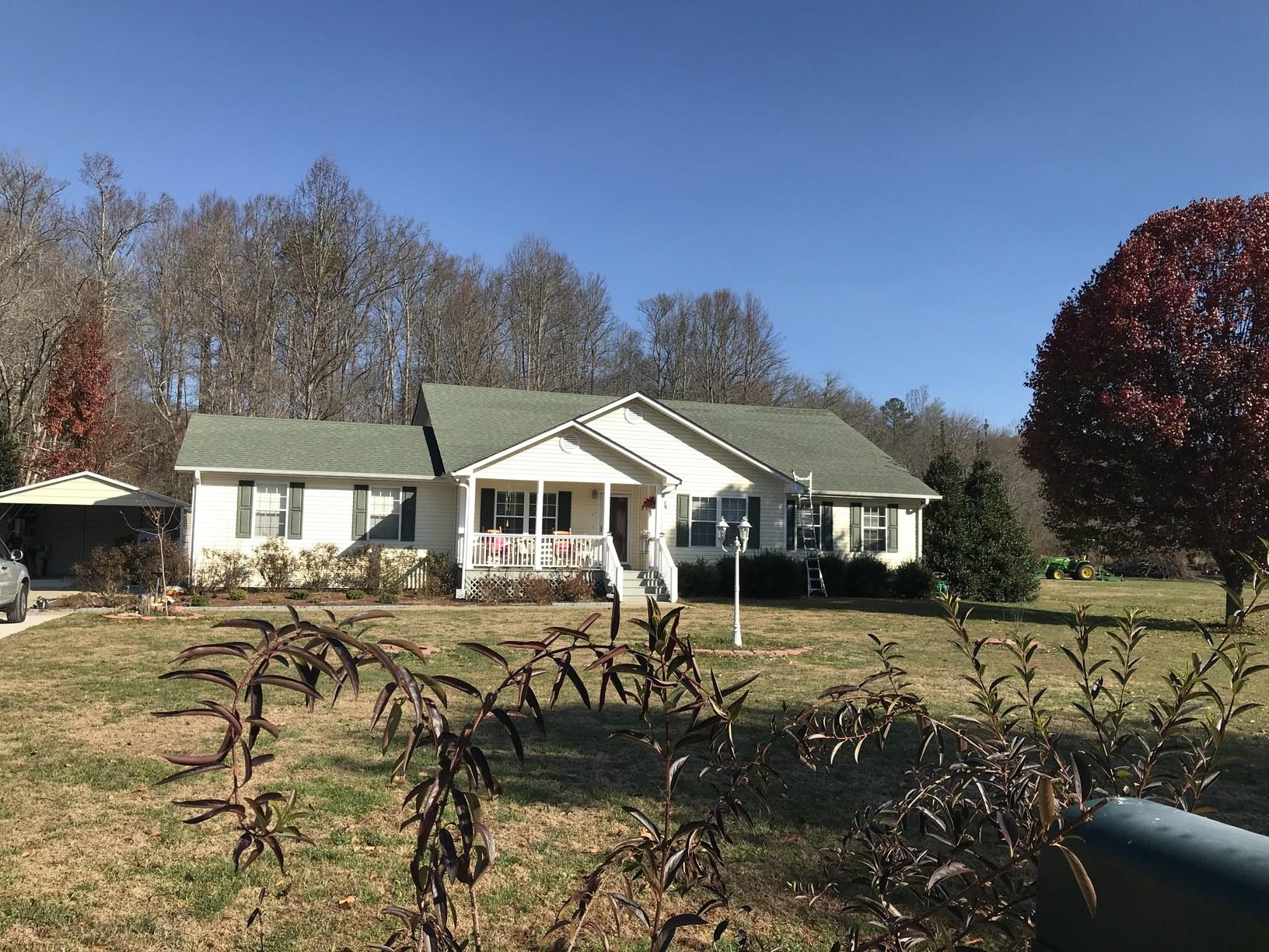 White side house with twilight black Owens corning shingle in Blairsville GA - Before Photo