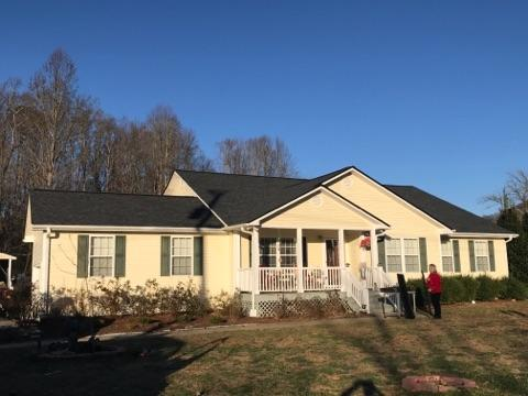 White side house with twilight black Owens corning shingle in Blairsville GA