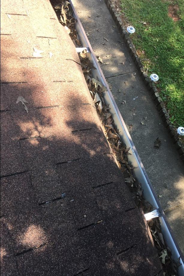 Gutter protection installed in Stockbridge, GA - Before Photo