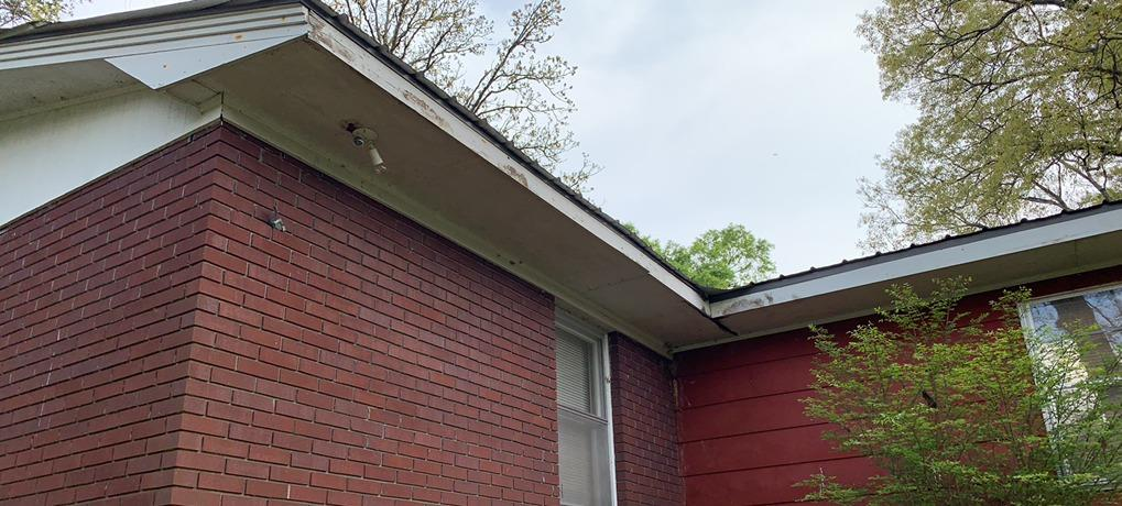 Gutters and siding repairs in Bowdon, GA - Before Photo