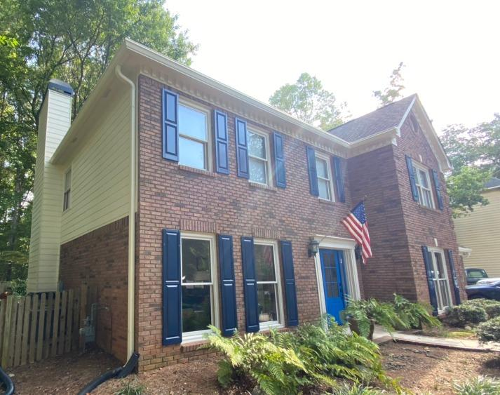 New gutters, LeaFree gutter protection and painting in Acworth, GA - After Photo