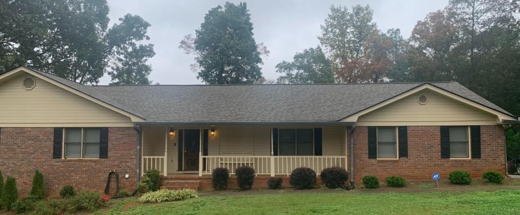 New Hardie siding, new gutters and exterior painting in Stockbridge, GA - Before Photo