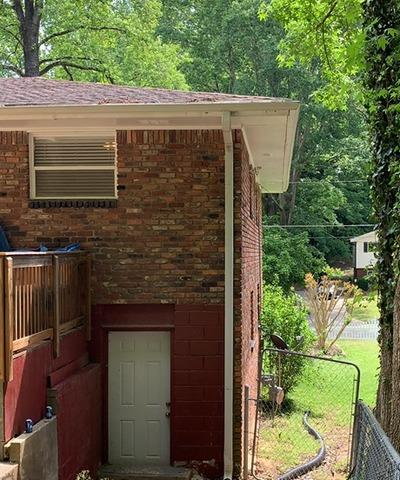 New gutters, soffit and fascia in East Point, GA - Before Photo