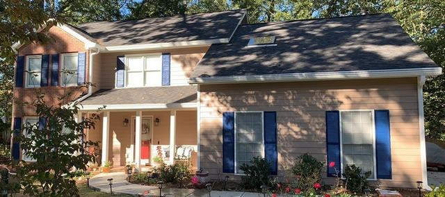 New Hardie siding, painting, gutters, and IKO Dynasty roof in Peachtree City, GA
