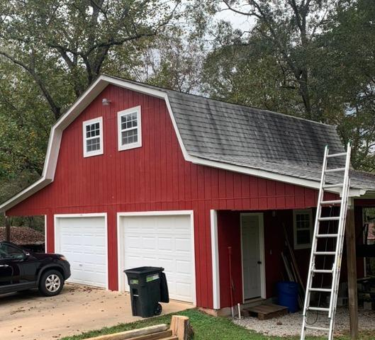 New roof, gutters and painting on this barn in Griffin, GA