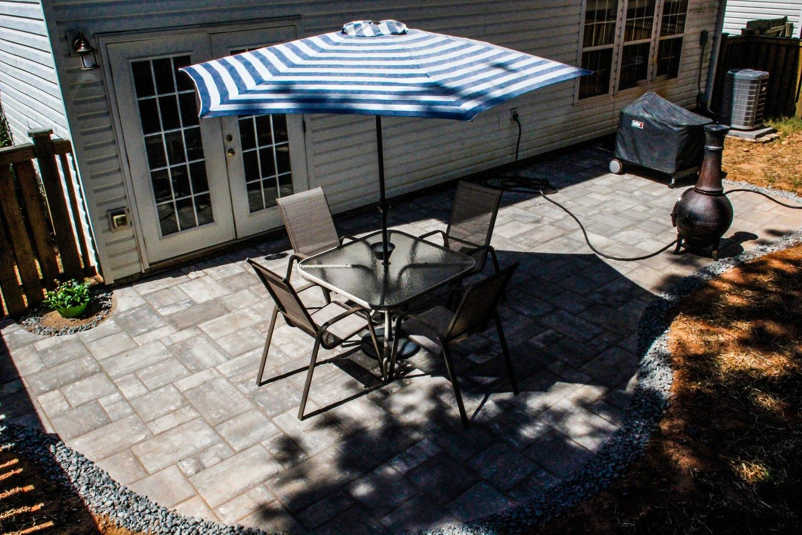 Concrete Slab Patio transformed in a Beautiful New Paver stone Patio - After Photo