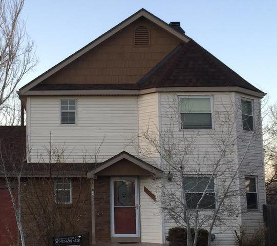Home Makeover with New Siding, Roof, and Gutters in Denver - After Photo