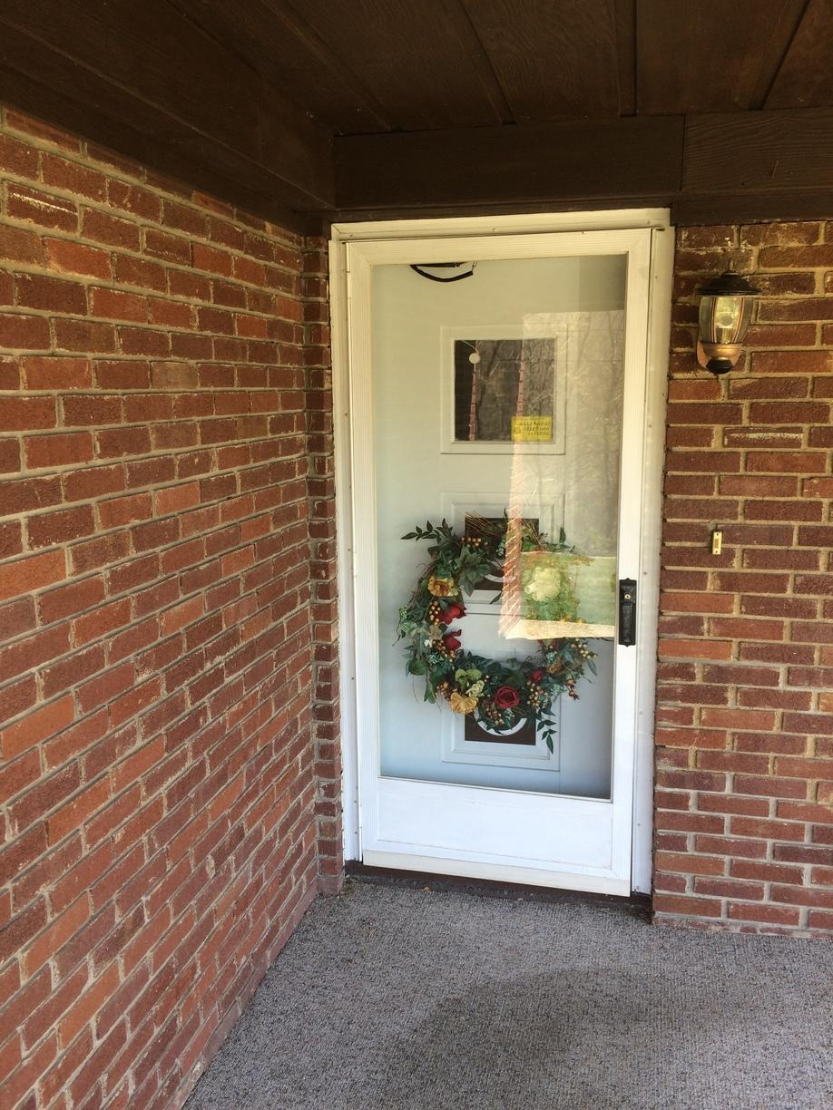 Outdated entry door replaced with beautiful new door in Greensburg, PA - Before Photo