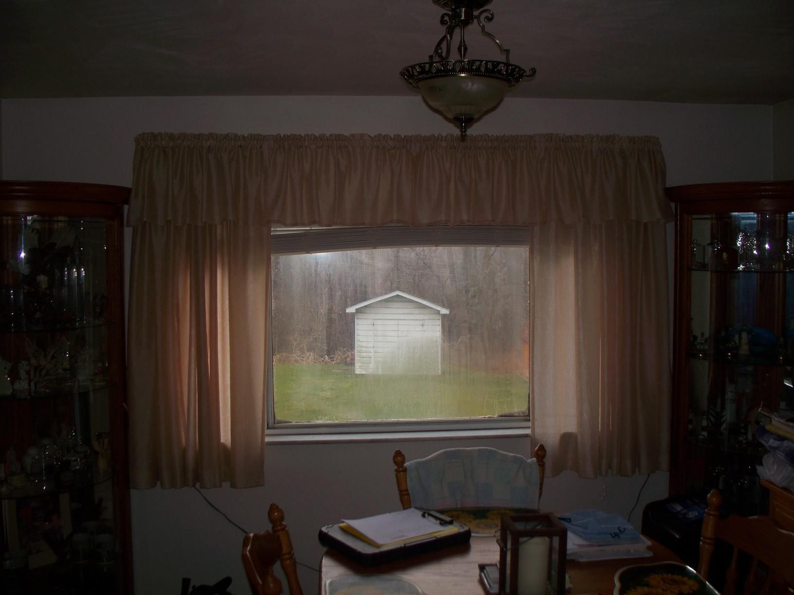 Old Slider Replaced with Double Hung Windows in North Huntingdon, PA - Before Photo