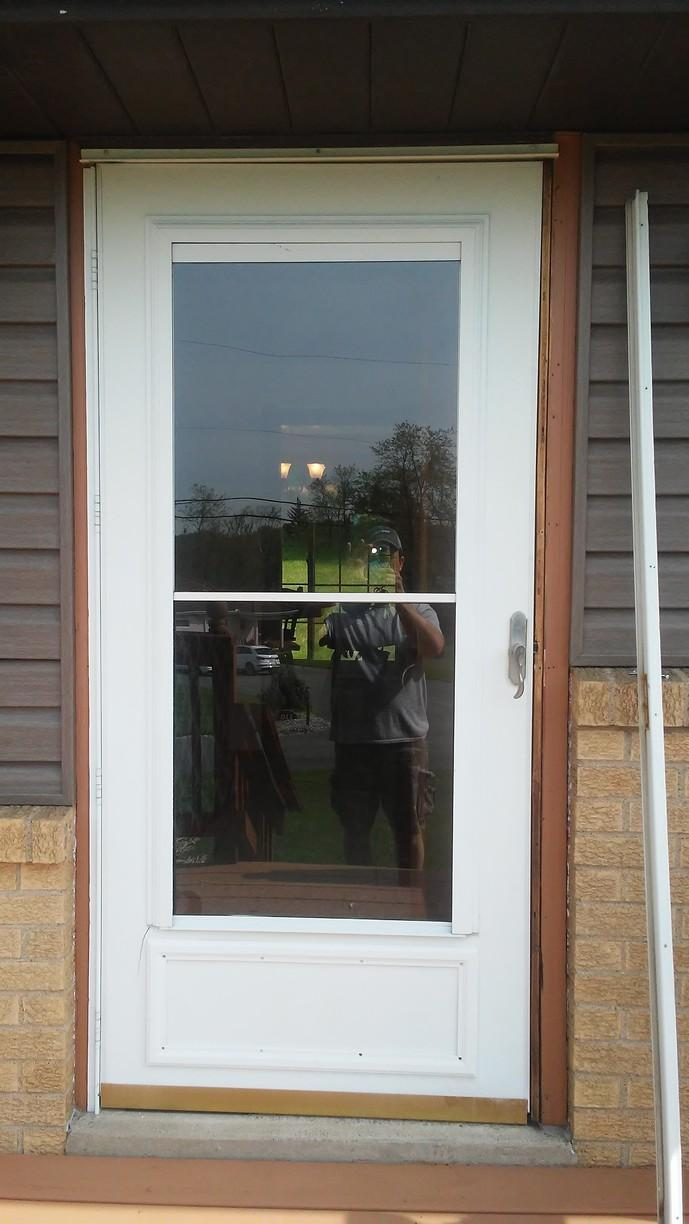 Home Makeover with New Entry and Storm Door Installation in Herminie, PA - Before Photo