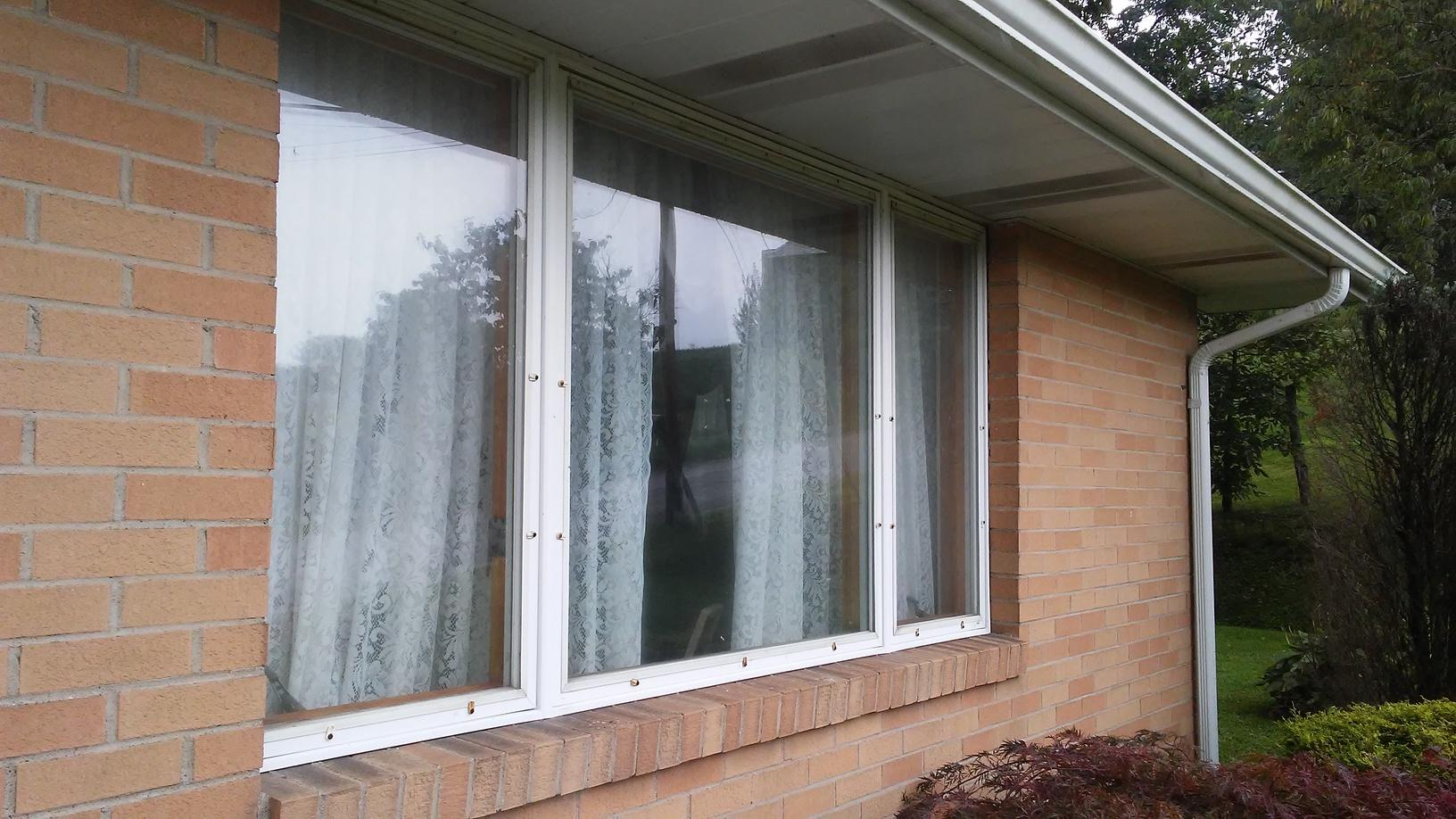 Old Aluminum Window converted into Beautiful Bay for Greensburg, PA clients! - Before Photo