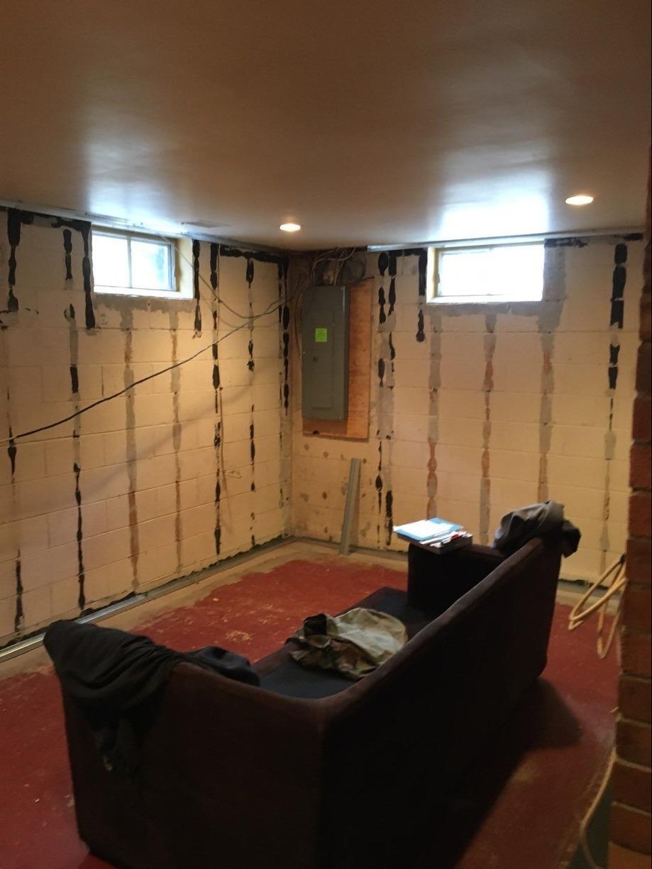 Flooring, Walls & Windows Installed in Fox Chapel Basement! - Before Photo
