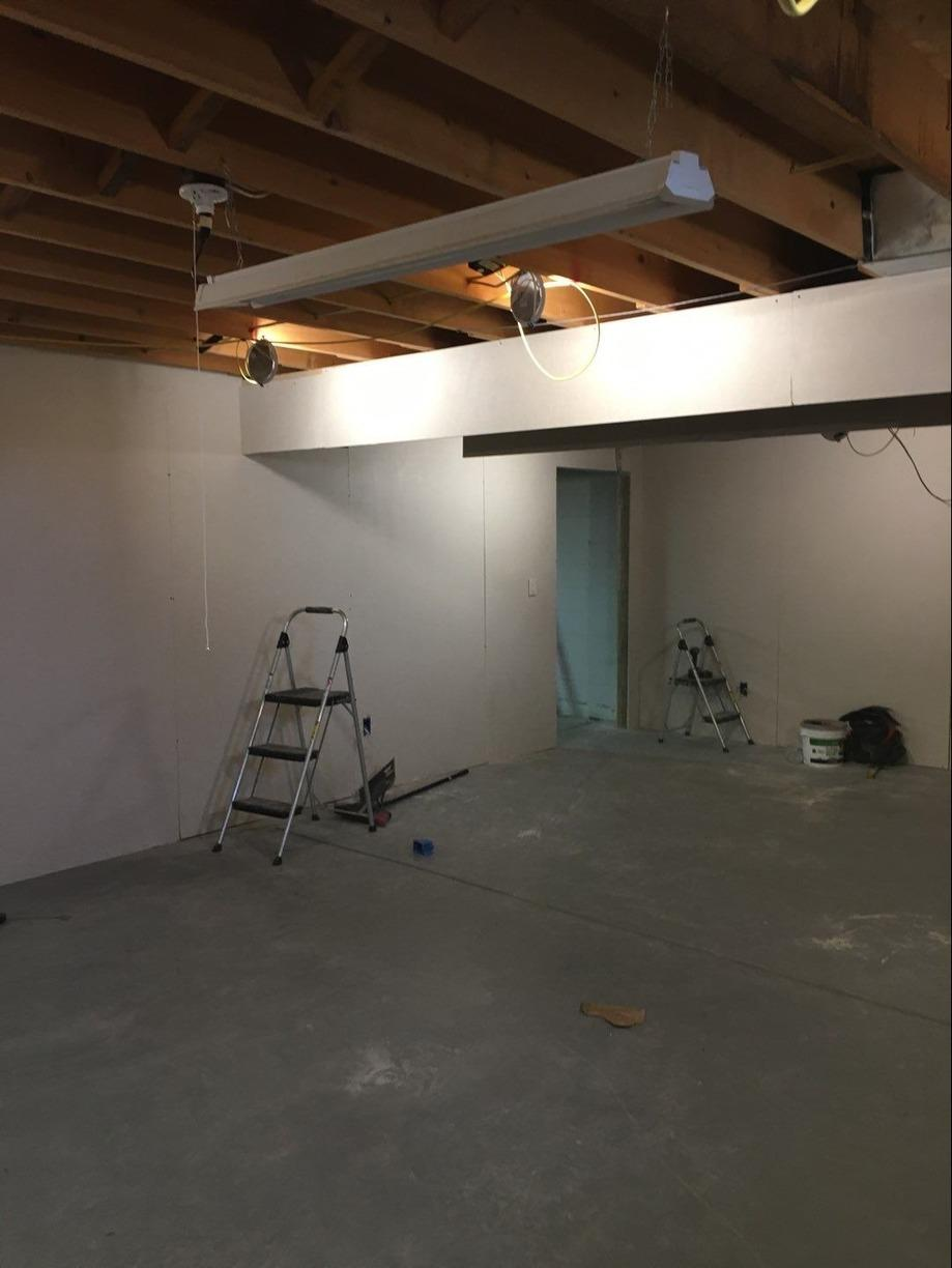 Unfinished Basement Becomes TV Hangout Space in Harrison City! - Before Photo