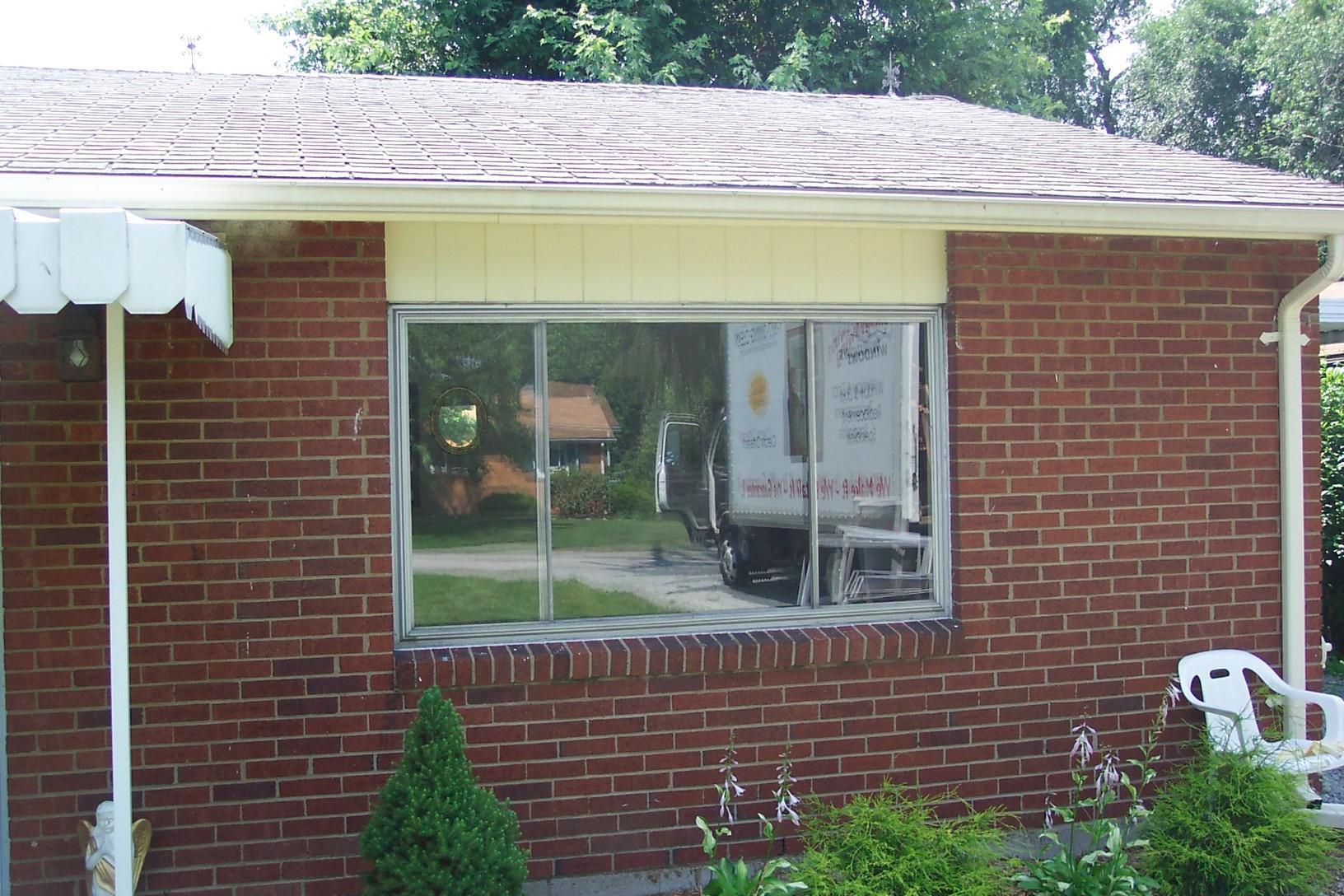 Three-panel slider window installation in Greensburg, PA - Before Photo