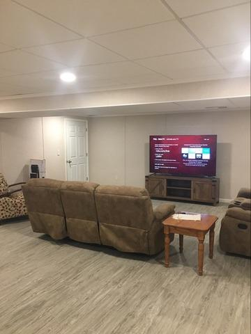 Unfinished Basement Becomes TV Hangout Space in Harrison City! - After Photo