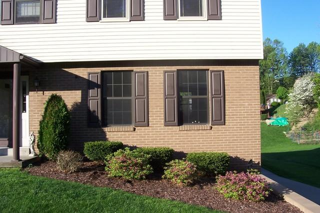 Brown windows replaced by tan double hung windows in Irwin, PA