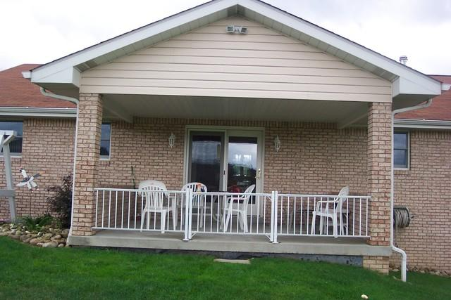 Porch enclosed with new windows and sliding glass doors in Greensburg, PA - Before Photo