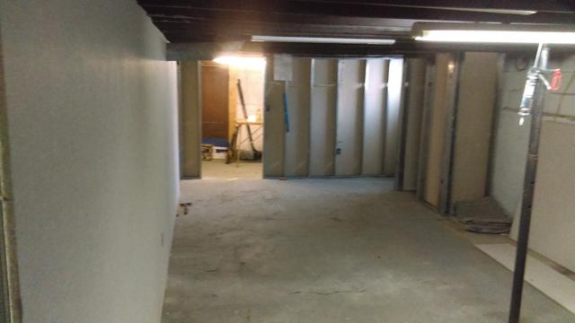 New Basement Flooring & Walls Installed in Angola, NY - Before Photo