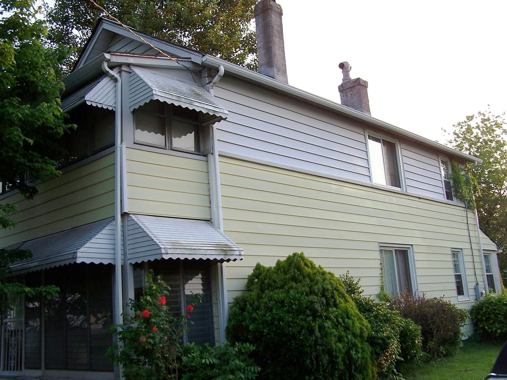 Full Siding Replacement - Before Photo